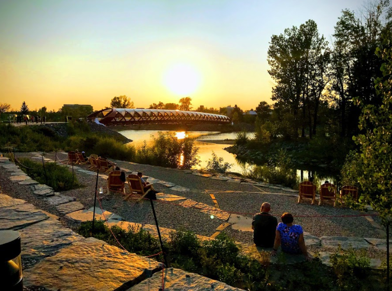 The new West Eau Claire Park pebble beach is the perfect sunset watching spot with the Peace Bridge on the horizon.