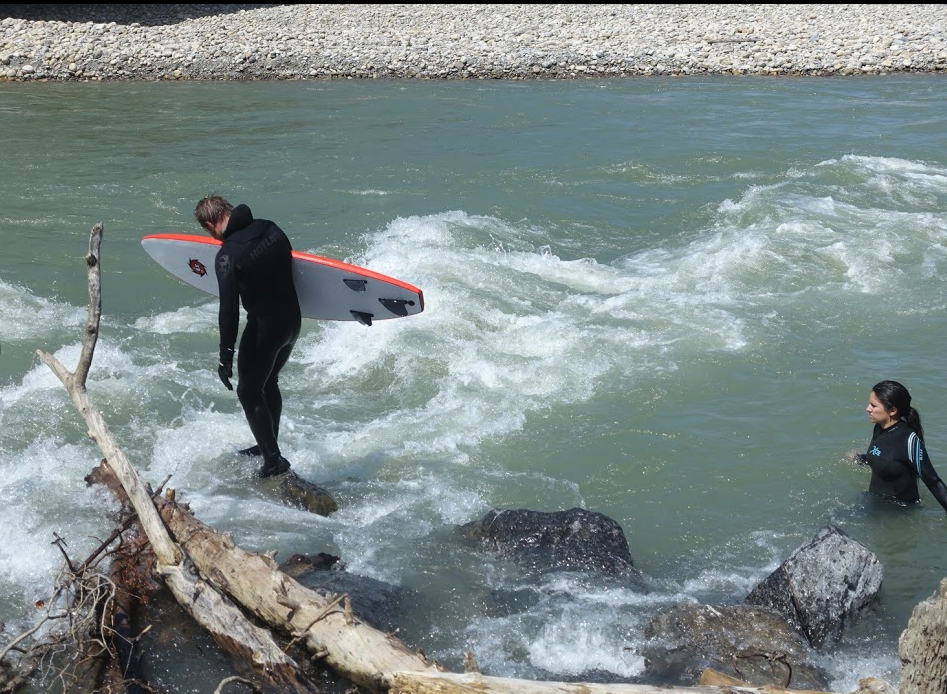 River surfing on the Bow River is popular at the Louise Bridge in Eau Claire