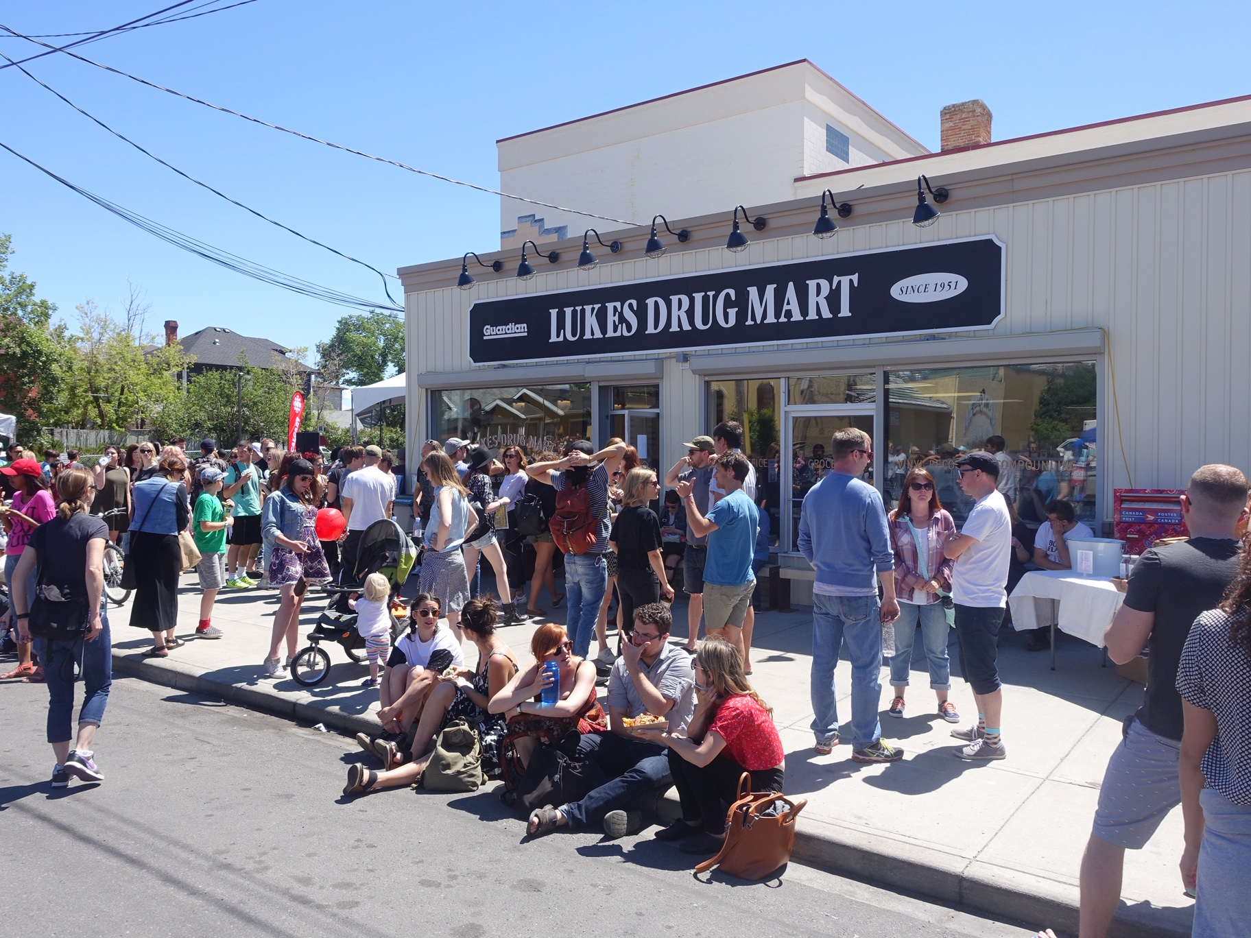 In Calgary's City Centre there are street festivals pretty much ever weekend from May to September like this one outside Bridgland's iconic Lukes Drug Mart a funky cafe, record store, grocery store, drugstore and post office.