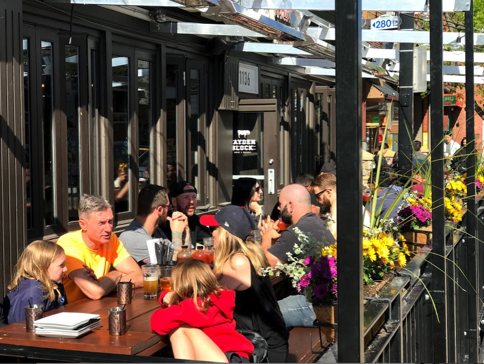 Kensington Village has numerous great restaurants with sidewalk summer patios.
