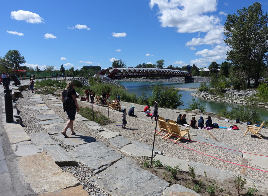 The new West Eau Claire Park includes a pebble beach that has become a poplar place sit people watch.