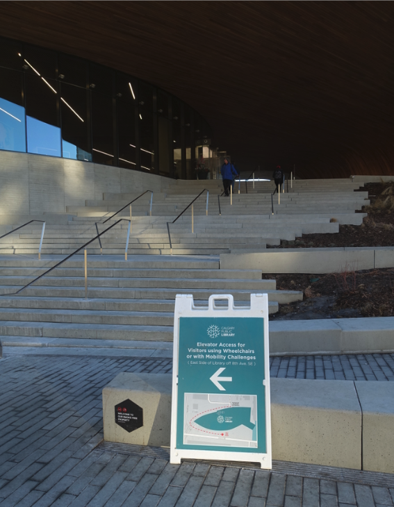 This is the 3rd St SE entrance (aka front door) to the new Central Library. Not only is it inaccessible for those who need an elevator it is not very inviting to anyone with its many stairs and the often dark forbidding plateau at the top.