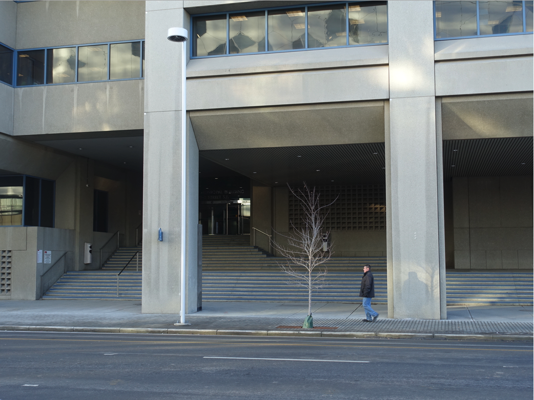 3rd Street SE backdoor entrance to the Municipal Building has been criticized for being very pedestrian unfriendly because of its stairs and dark entrance.