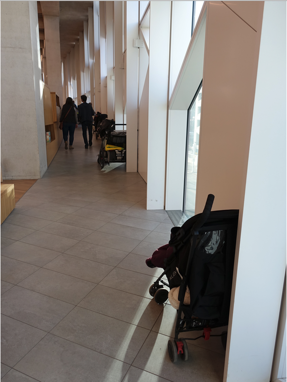 The interior ramp for those in wheelchairs or with strollers located on the perimeter of the building, is also very restrictive.