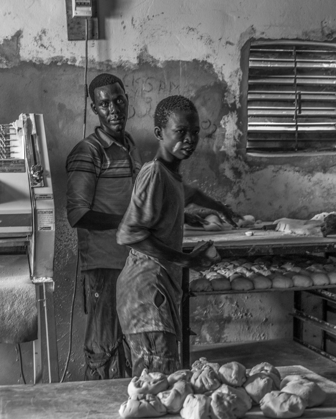 Village Bakery, N' Doul, 2016   The bakery was housed in a small industrial building, there were no counters and the bread was dispensed from boxes. The children who were working there ranged in age from maybe eight to twelve. Child labor is a continuing problem and one that I witnessed too often in my travels.