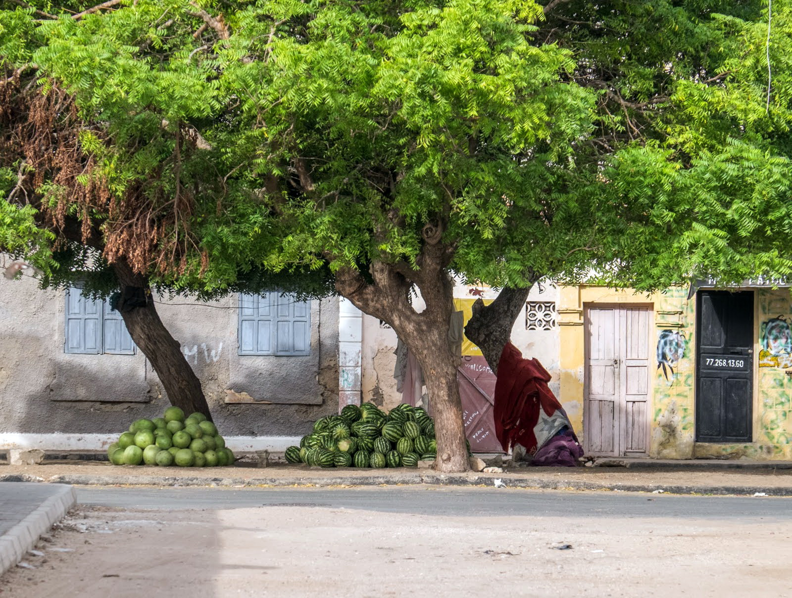 We were in Senegal at the height of the harvest season for many fruits and melons. It was common to see piles of watermelons along the roads and stacked on sidewalks, like the ones in the photo. Many of these fruit stands seemed to be unattended, I assume that buyers would select a melon and then pay the grower directly.