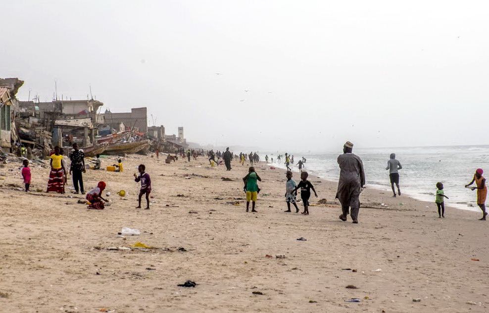 The fishing beach, St. Louis, Senegal. Hundreds of dilapidated houses, little more than shacks, crowd the edge of the beach in St. Louis, often with fishing boats tucked between them well above the tide. The children mainly play on the beach as there is virtually no other open space in the fishing village. Adults seem to commonly use the beach as a sidewalk to visit friends and neighbors. We were tolerated, but not really welcome on this garbage-strewn beach. We had hoped to see the boats coming in and unloading their catch, but our timing was off.