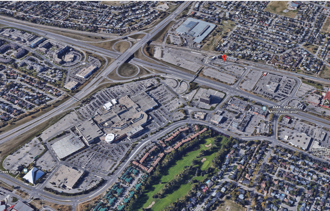 Google Earth image of Calgary's Anderson LRT Station (see red mark, not sure why it worked on this one) surrounded by surface parking lots and major roads. There is poor pedestrian connectivity to the Southcentre shopping mall, Fish Creek Library and surrounding neighbourhoods. .