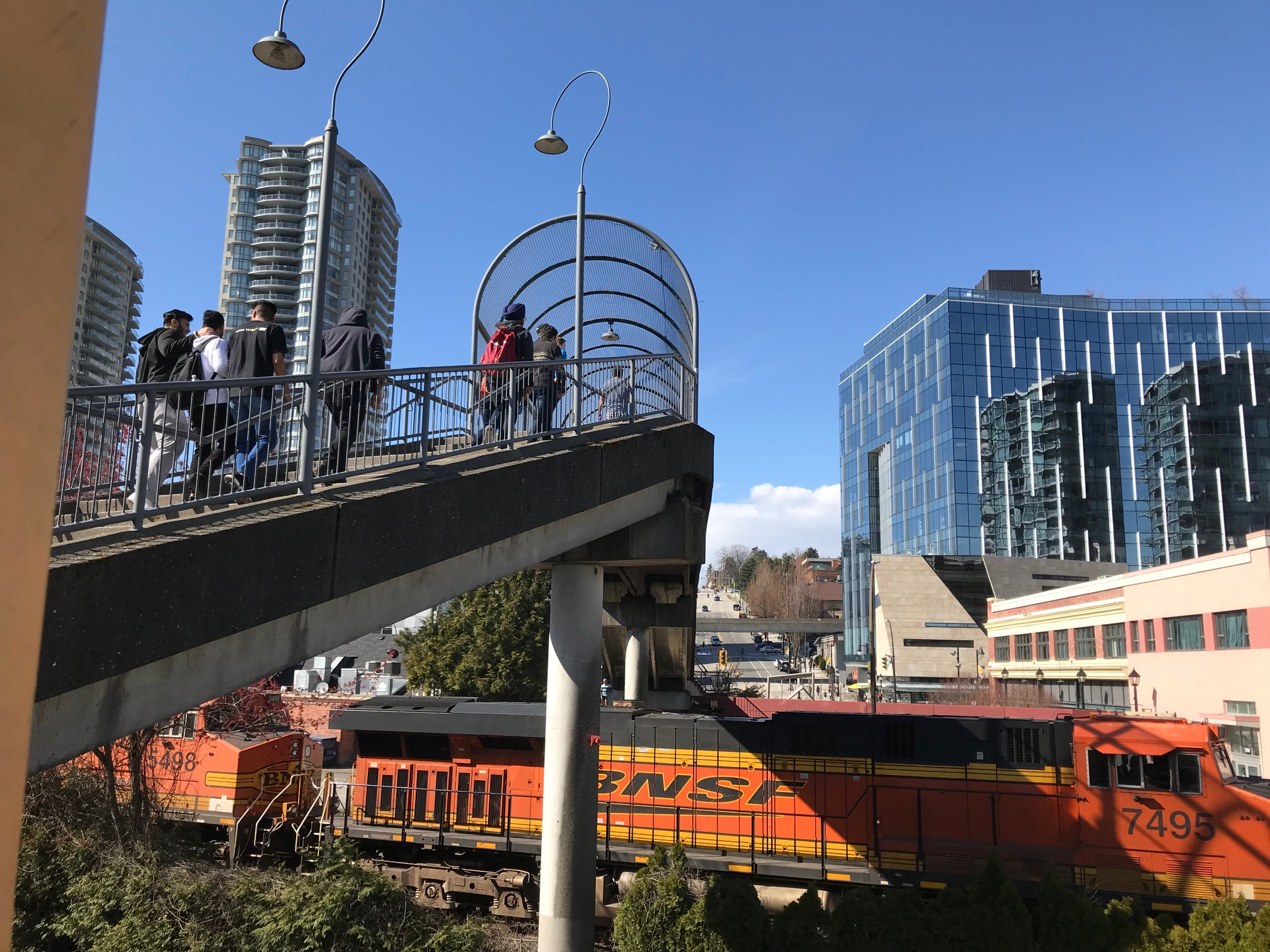 The New Westminster SkyTrain station is right next to heavy train tracks, like the south leg of Calgary's LRT but they have managed to still create urban village next to the tracks.