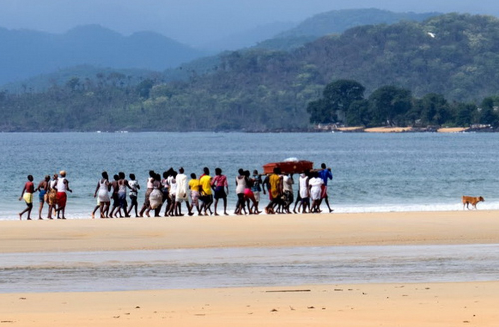 One afternoon we were surprised to see a funeral party and pallbearers trooping down the beach to a small village that had no road access. At least two streams had to be forded by the group, that prevented many of the guests from getting to the village to attend the burial.