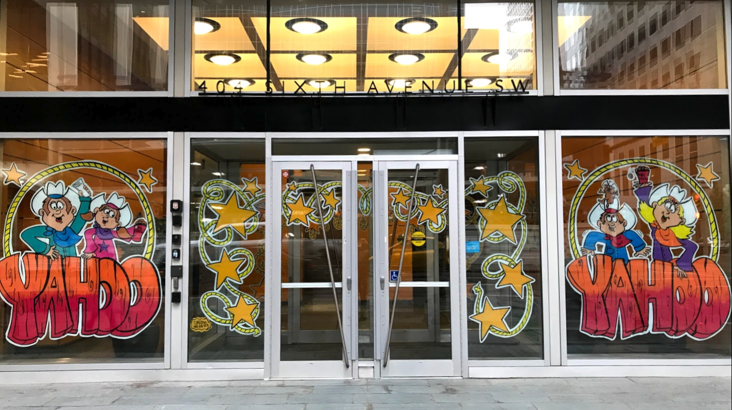Only a few of the 100+ Calgary downtown office buildings have their entrances decorated to celebrate Stampede this year. It use to part of the Stampede tradition to create fun (and yes tacky for some) windows.