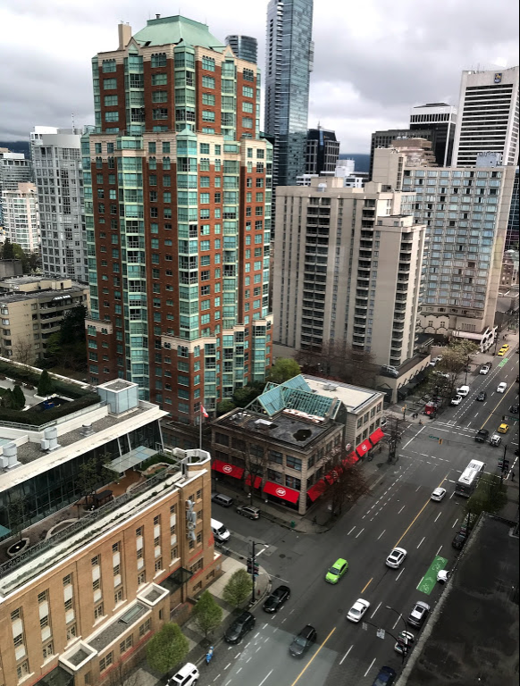 I read somewhere that there is something like 30 grocery stores in Vancouver's City Centre.  This two level IGA integrated into a residential building providing a human scale structure next to the pedestrian street.