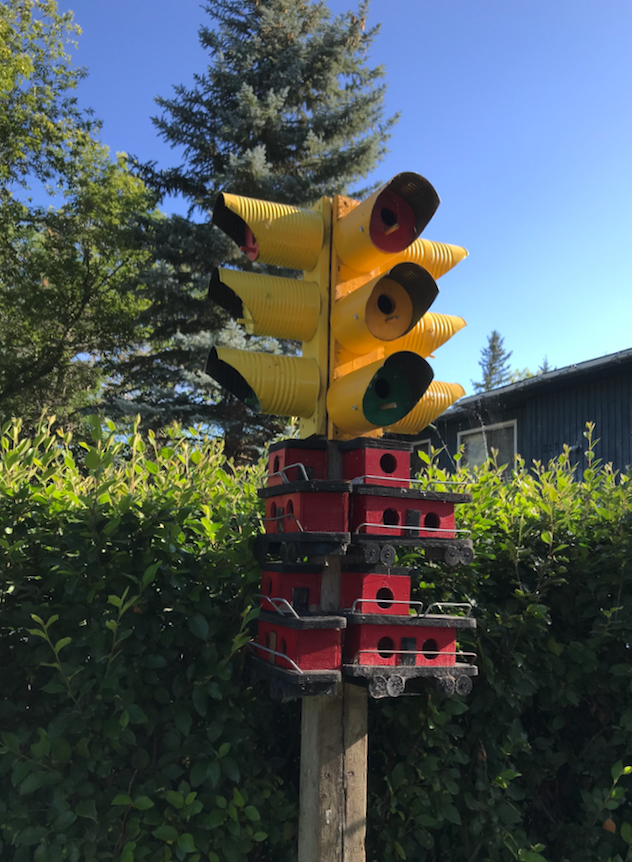 Loved this quirky homemade birdhouse that combines traffic lights with railway cars. The entire front yard was like a folk art gallery.