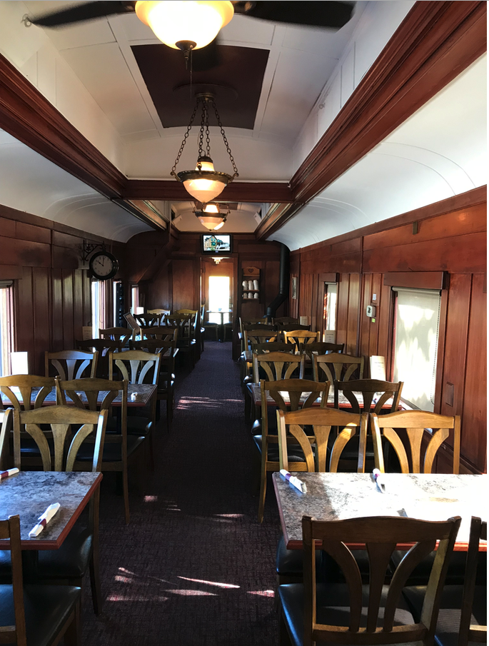 "The highlight of the Aspen Crossing visit was having a coffee in the Diefenbaker Dinaing Car. It was purchased from Chicago to become Prime Minister John Diefenbaker's ""whistle-stop"" rail car from 1958 to mid-1960. After 1962, John George Diefenbaker used the Pullman car as his private business car. Rumour has it, it once belonged to an ""infamous gangster club."""
