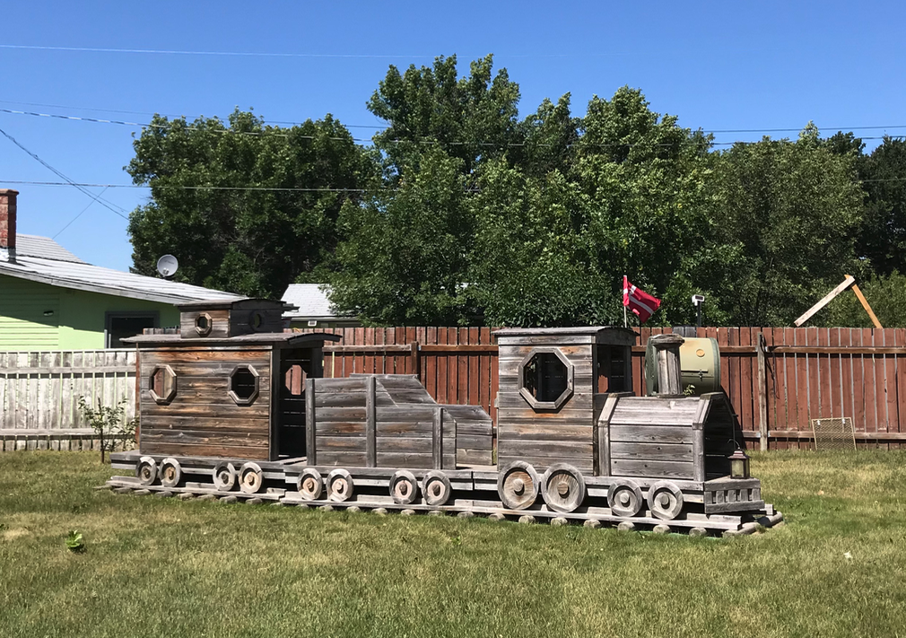 Next stop Nobleford population 1,280 where we found this charming wooden train in a backyard. Nobleford has realized an amazing revitalization since 2005 with a population increase of 50%, a 300% increase in employment and possibly the lowest municipal taxes in Canada.