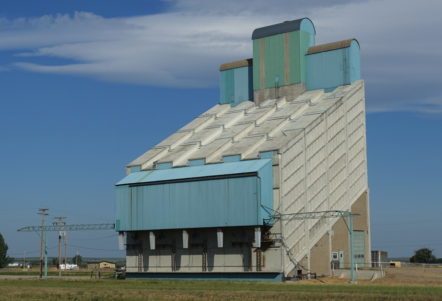 Love how this modern grain elevator has a miniature historic grain elevator on the top, but with a rounded roof rather than a pointed pitched roof.