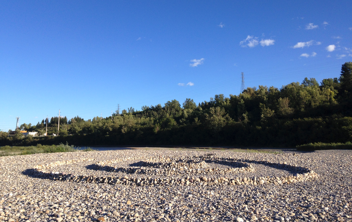 The huge gravel bar in the Bow River is a popular spot for people to create rock formations like this one.