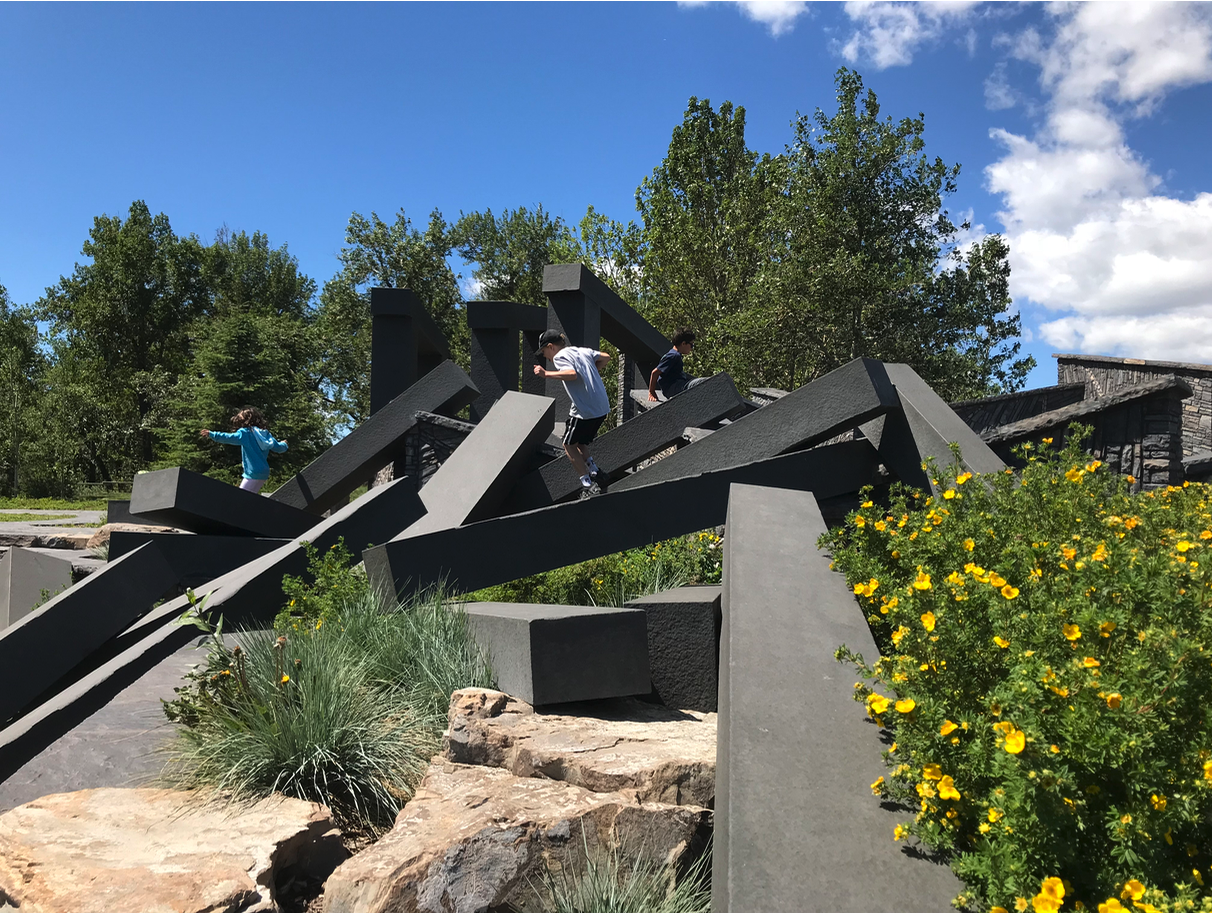 "And don't miss the impressive public artwork by Lorna Jordan. Titled ""Bow Passage Outlook,"" it looks like a bunch of railway ties tossed on a hill. Kids love climbing the sculpture; couples and families love to sit on the beams, which if you climb to the top, offers a great view at the top of the majestic Bow River."
