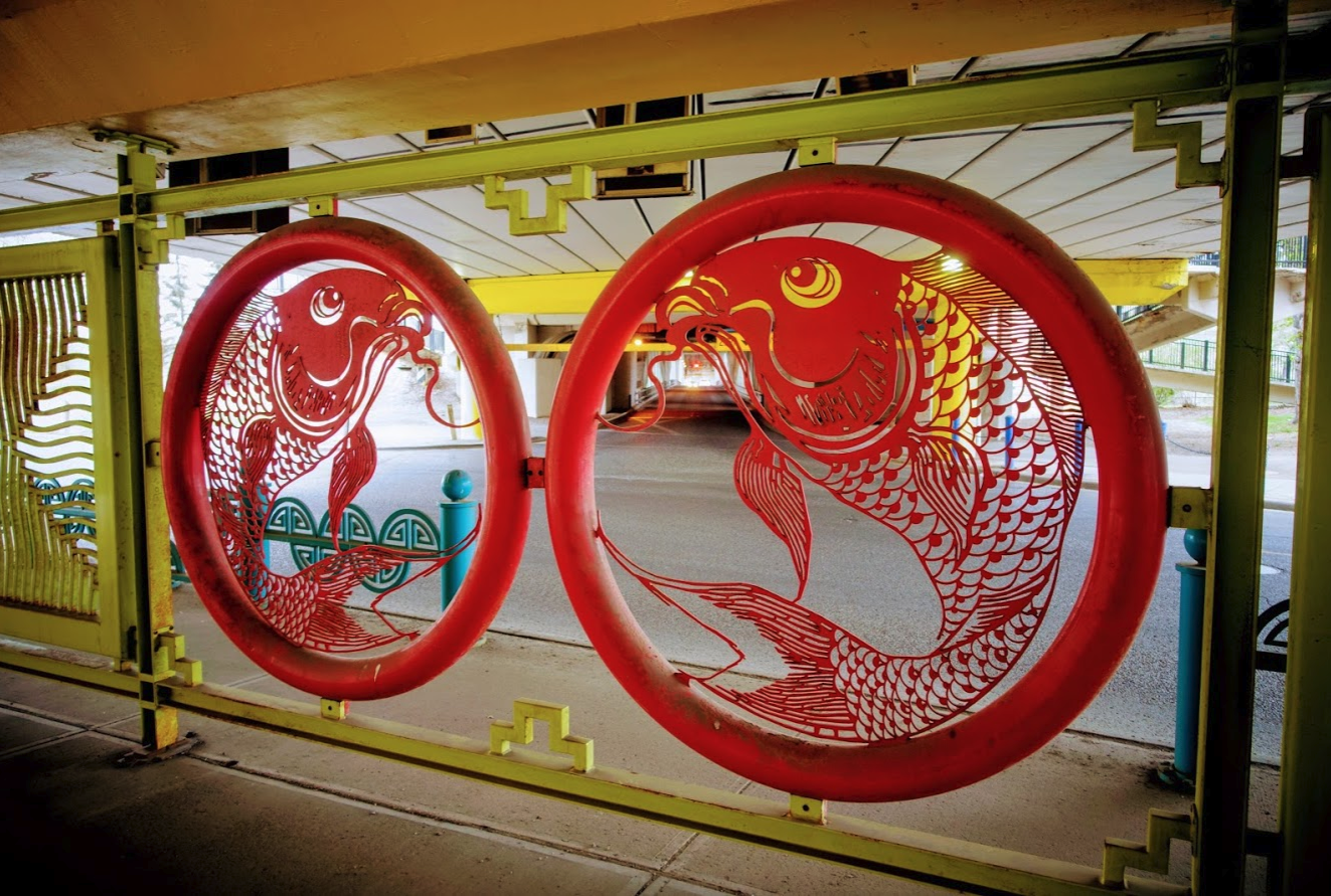 As you pass under the Centre Street bridge don't miss the decorative Chinatown fence.