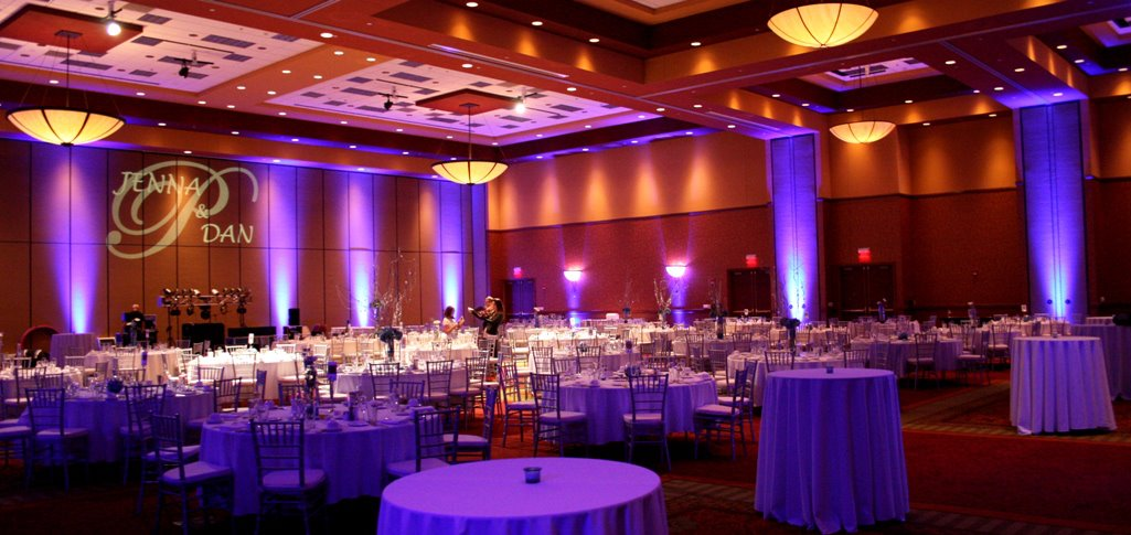 Elegant Room Lighting can make all the difference in your reception. Here is an image from a wedding reception at Embassy Suites in East Peoria.