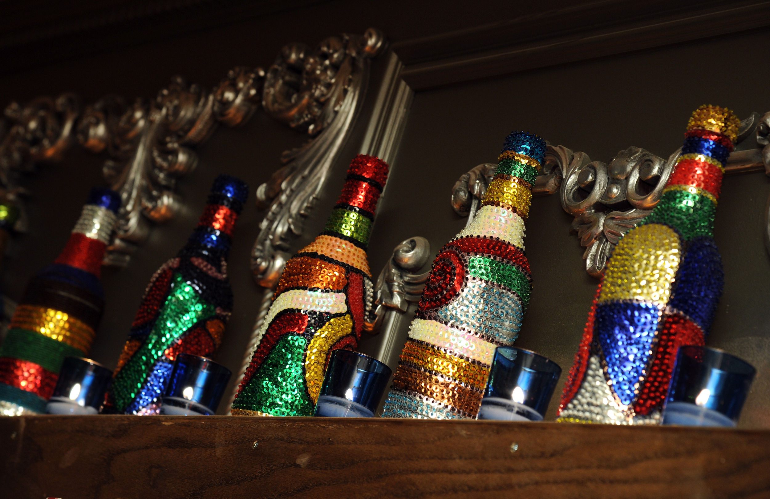 HAND-DECORATED BOTTLES FROM HAITI