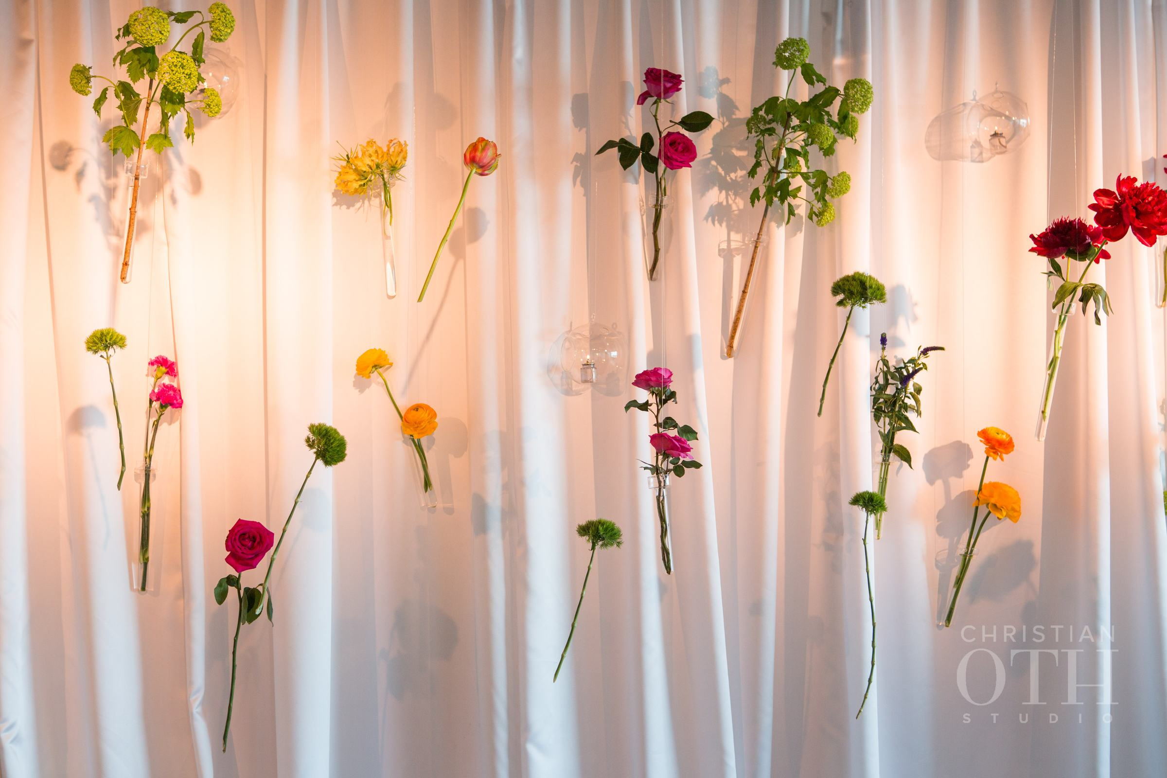 INSTALLATION OF BRIGHT HANGING FLOWERS IN TEST TUBES