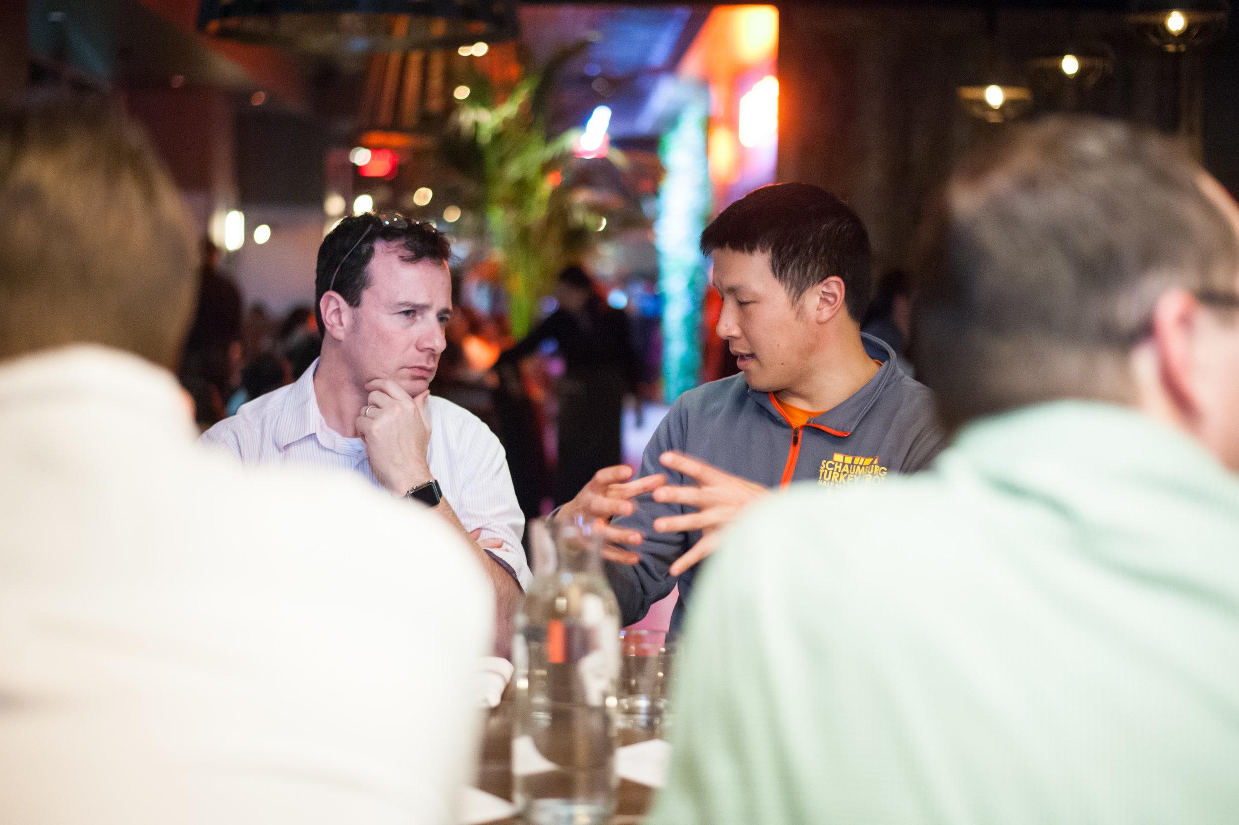 YEC members deep in conversation