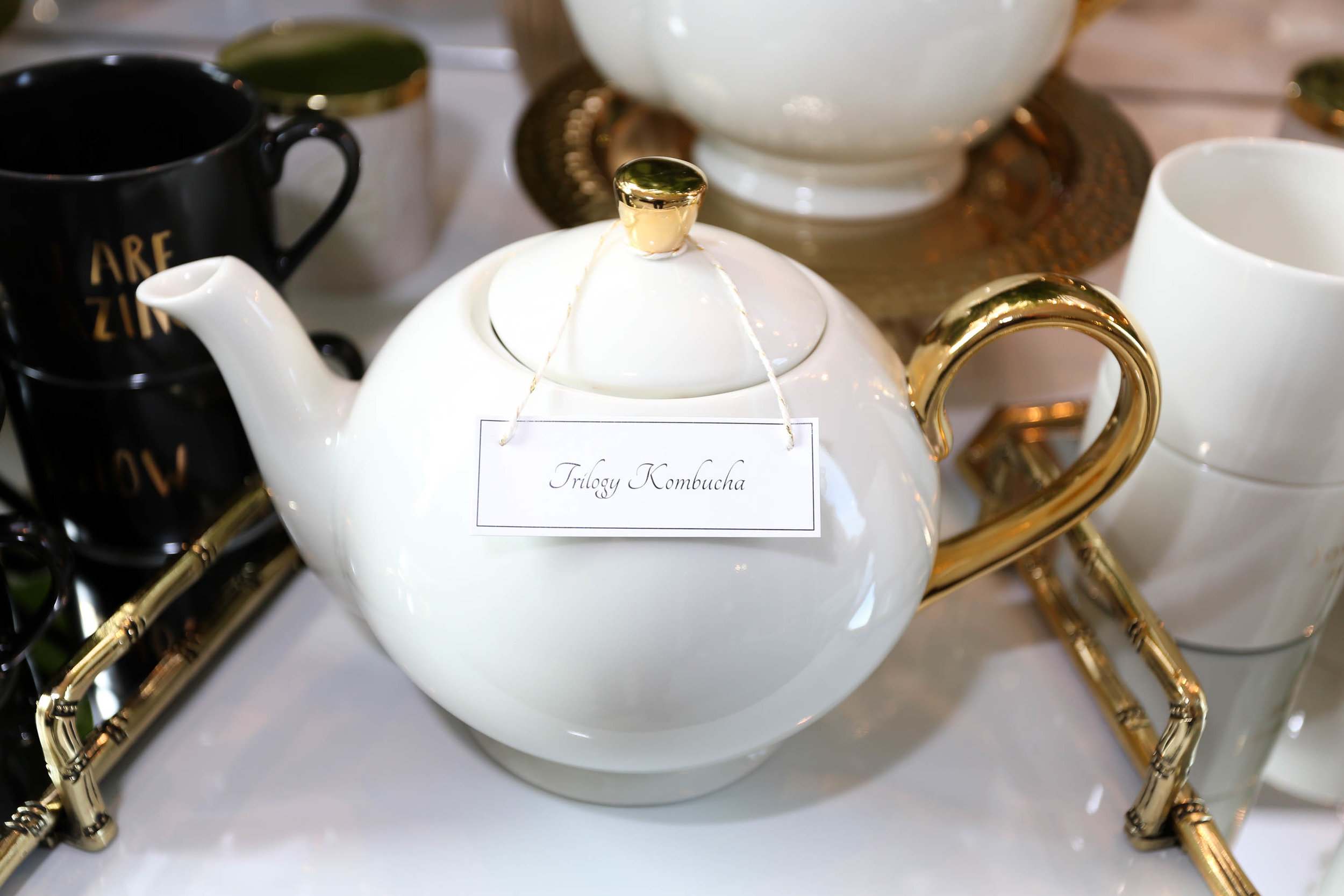 Trilogy Kombucha in H&M Home Collection gold accent teapot