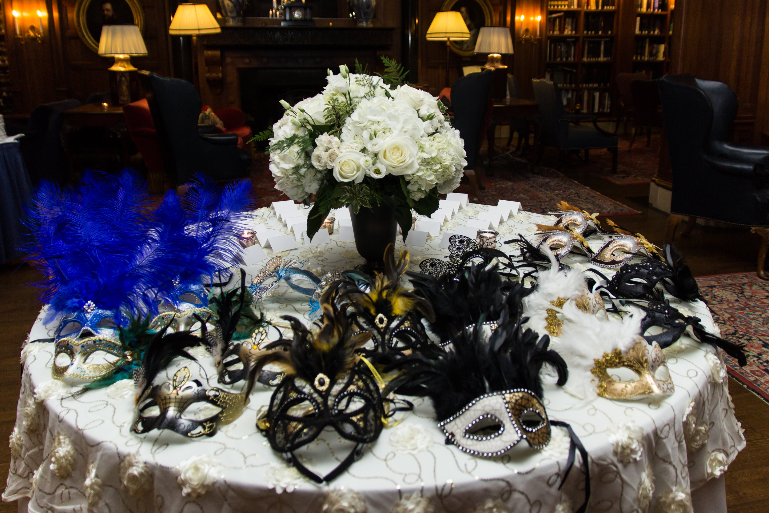 Masquerade masks trimmed with lace and feathers
