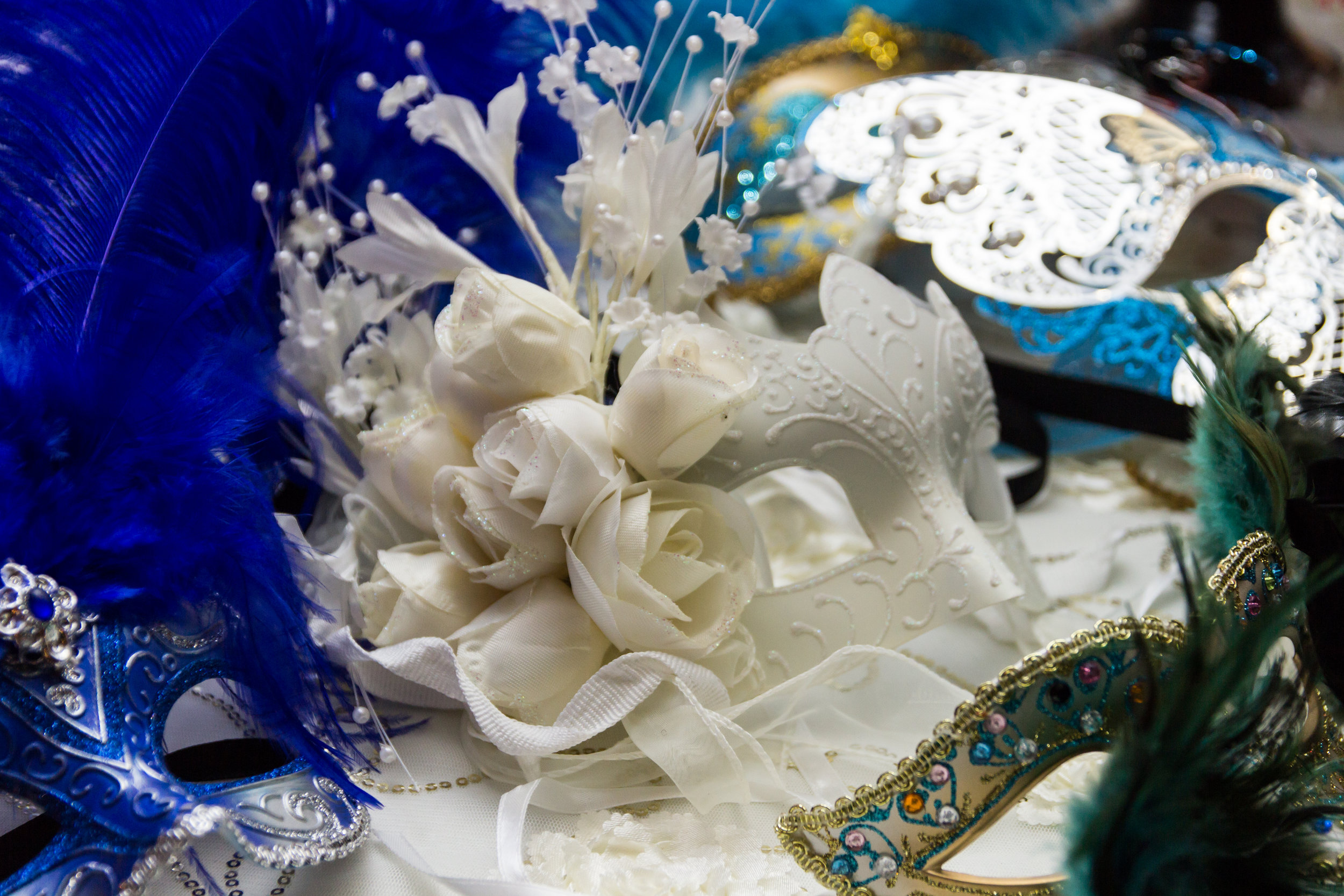 Snowy white mask with silky white roses