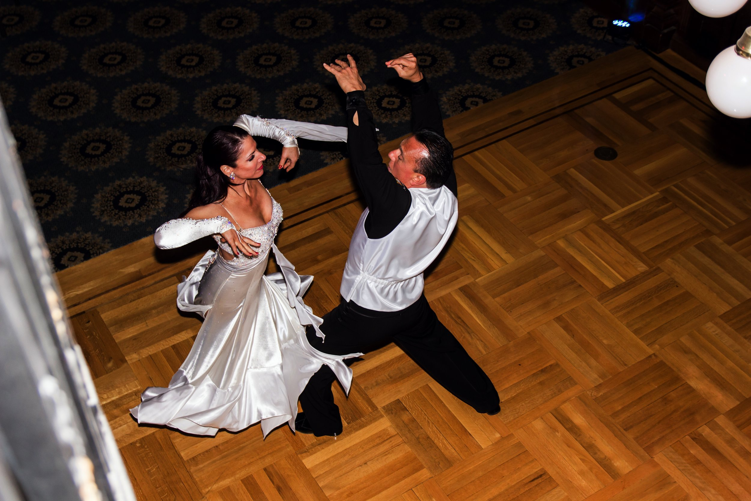 Professional dancers welcome guests to the dance floor