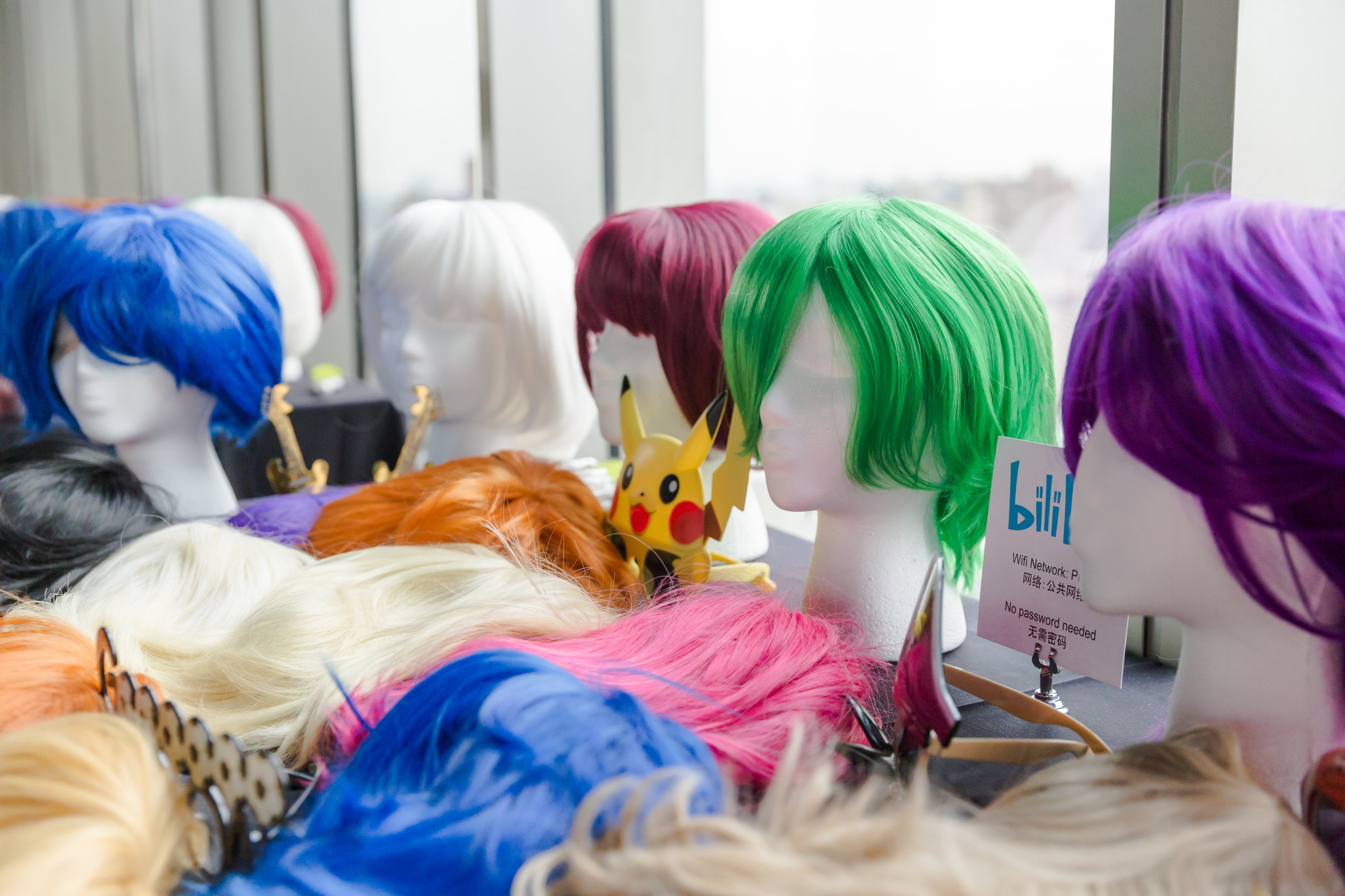 Colorful wigs and specialty sunglasses