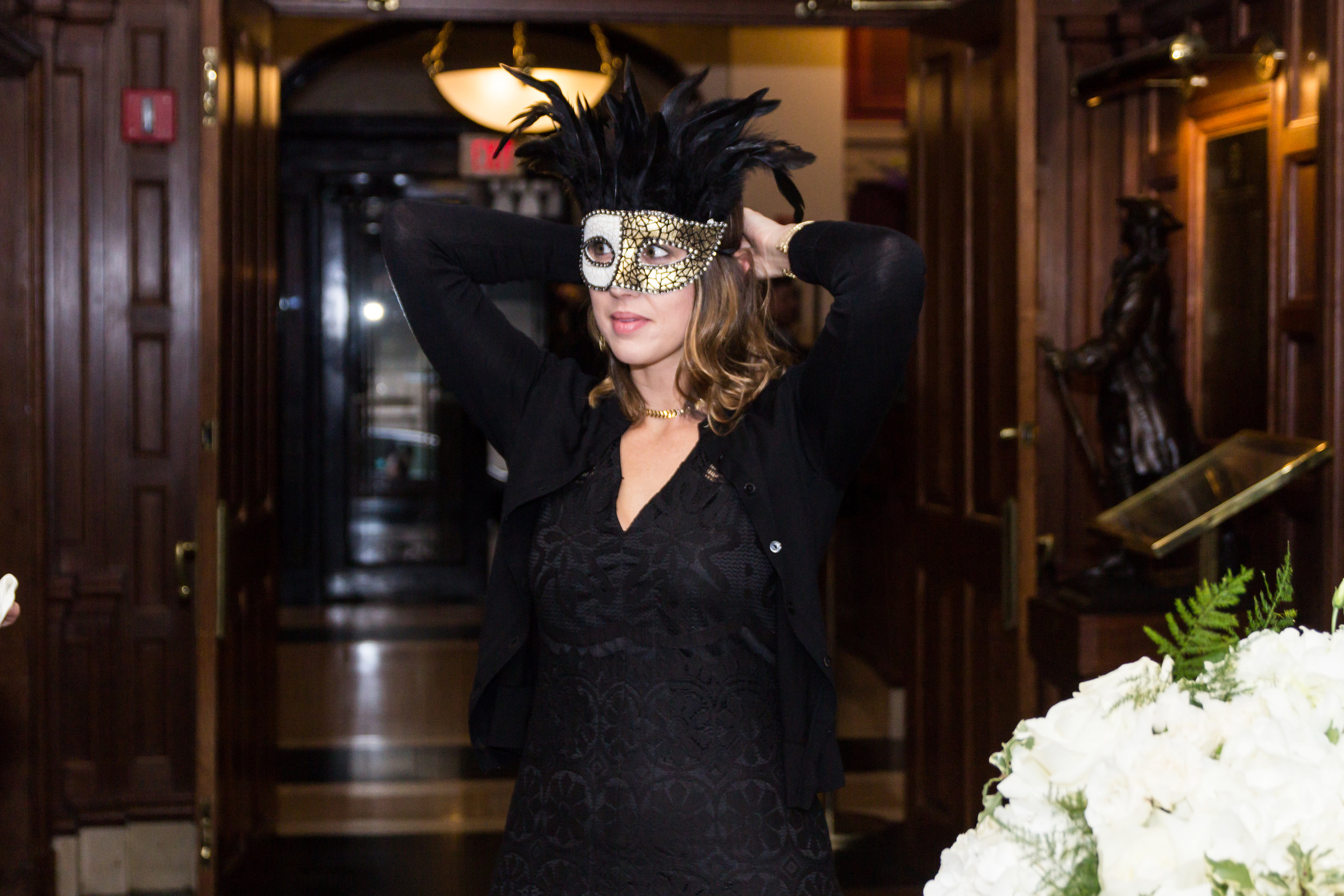 Guest chooses her mask before heading into cocktail reception
