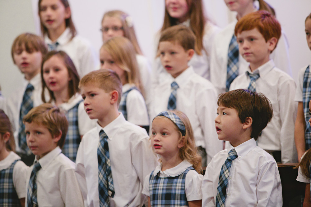 The All School Choir performs our National Anthem.