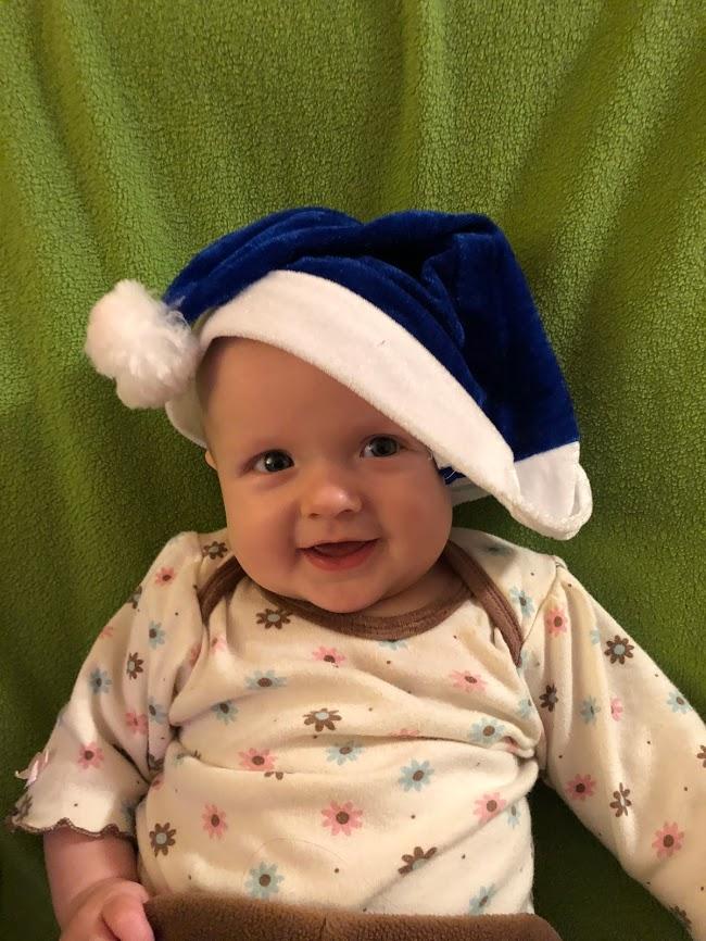 KJ in blue Santa hat