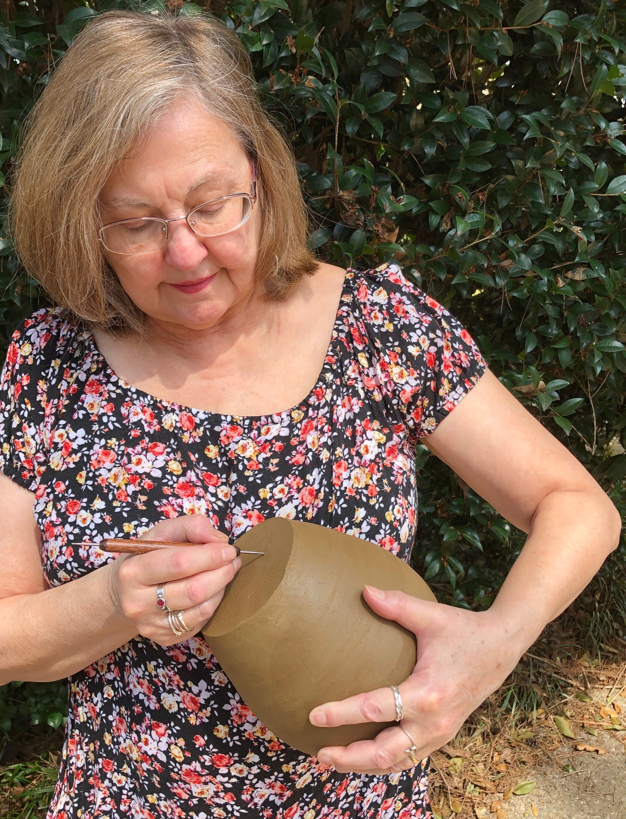 Mary Mayes  I have deep geographic roots and so do my pots. I intend for my connection to place to be present and visible in my pottery. When a future archeologist finds shards from one of my pots, I want them to know from where and when it came. I assume that evidence of the present will be obvious. They'll be able to name my teachers, see what purchased tools I used and generally read the inevitable influence of the internet and modern life. But I also want them to be able to see the influences of history: the traditional Georgia folk pottery and that of the Creek and Cherokee people who lived here before us. When you handle one of my pots, I want you to feel a connection to me, as well as to this geographically, botanically, historically and culturally rich place we live. I throw my pots with Georgia sourced red clay, and finish them with glazes I created from Georgia minerals and traditional slip glazes fired to stoneware temperatures. I am originally from Atlanta (with strong family roots in rural Georgia), but have lived here in Athens since 1976. I began making pottery in 1999 and have been part of the Good Dirt community off and on ever since.
