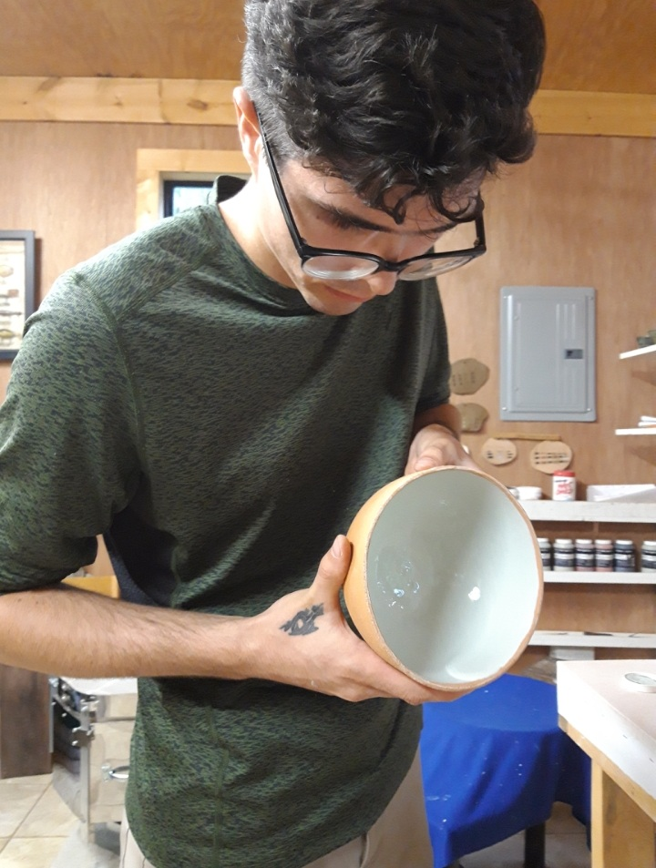 Christopher Marbut  As someone who is fascinated with the ways I interact with the world around me, pottery has become a passion of mine on both a physical and philosophical level. I believe this carries through, with my pieces reflecting and expressing the process through which they were created. As someone relatively new to pottery I am constantly trying to explore new methods, forms, and materials to further educate myself on the possibilities before me. My goal is for this sense of curiosity to be expressed in my work and for it to act as a reminder that there is always something new to learn about my environment.