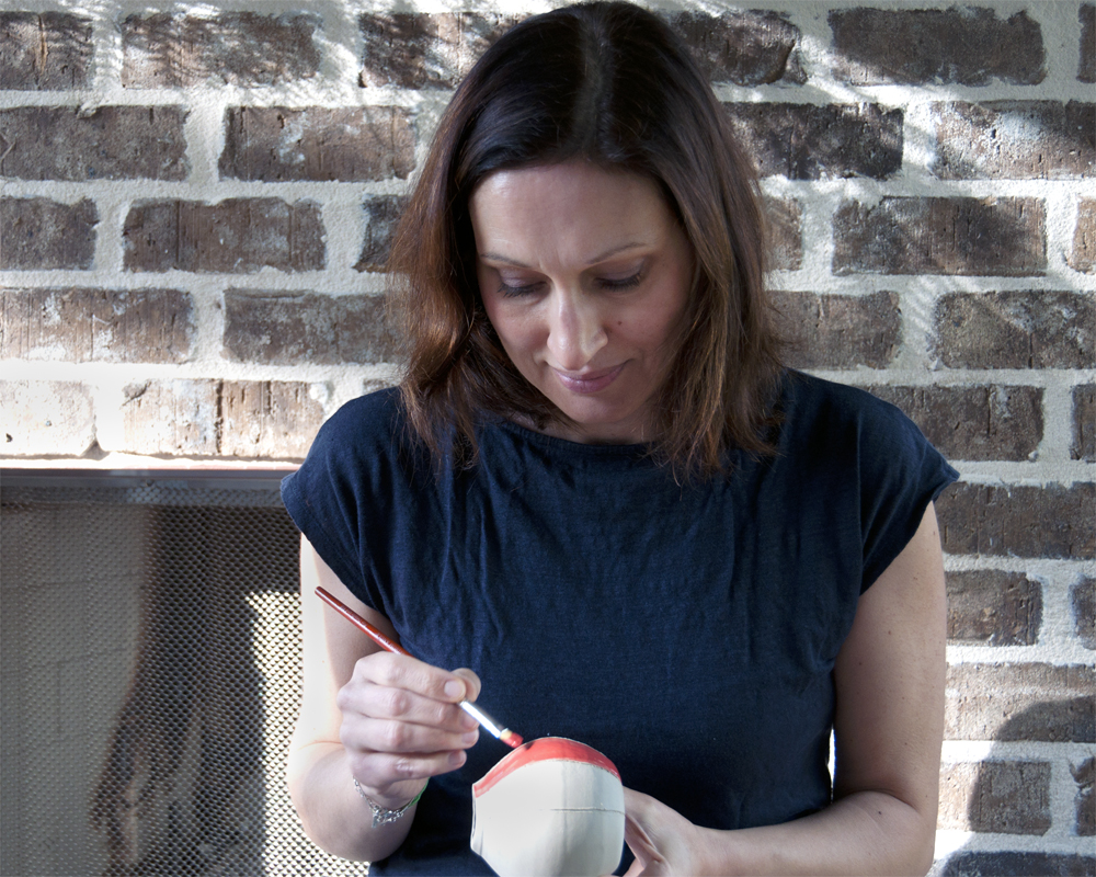 "Sandrine Zawacki  Sandrine Zawacki has been making pottery on the wheel at Good Dirt for more than ten years. She has recently enjoyed carving designs on her mugs and bowls. Particularly interested in the blurry boundaries between what people consider purely functional objects and ornamental ones, she is also currently working toward a Ph.D. in Sociology. With a focus on potters and pottery in northeast Georgia, her goal is to better understand the social, economic, and institutional divisions drawn between the worlds of ""art"" and ""craft."""