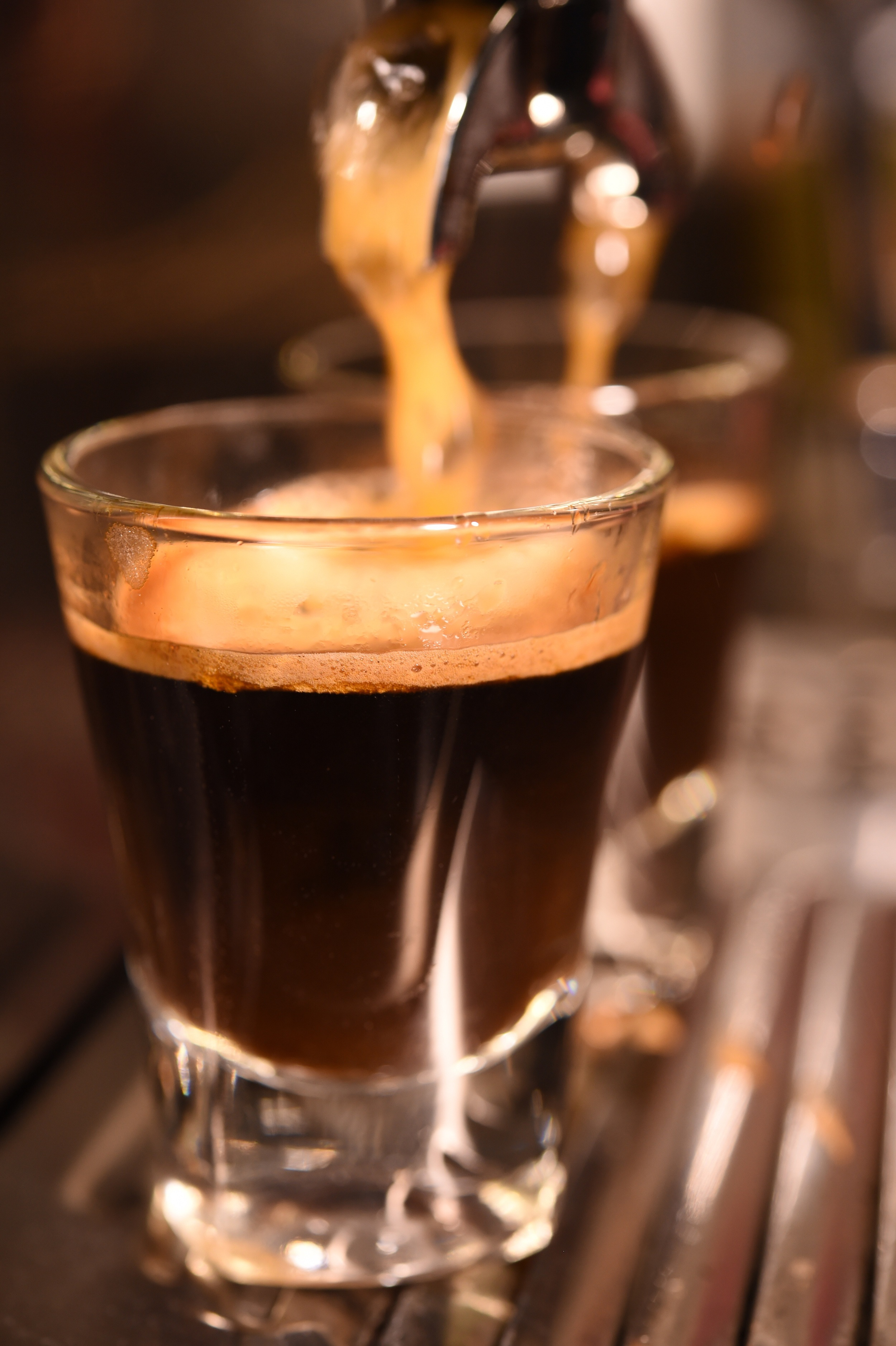 A small volume of liquid and concentrated coffee that has been extracted under pressure defines an espresso