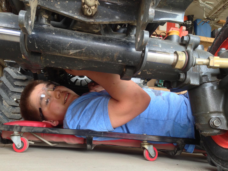 Ben under the tractor