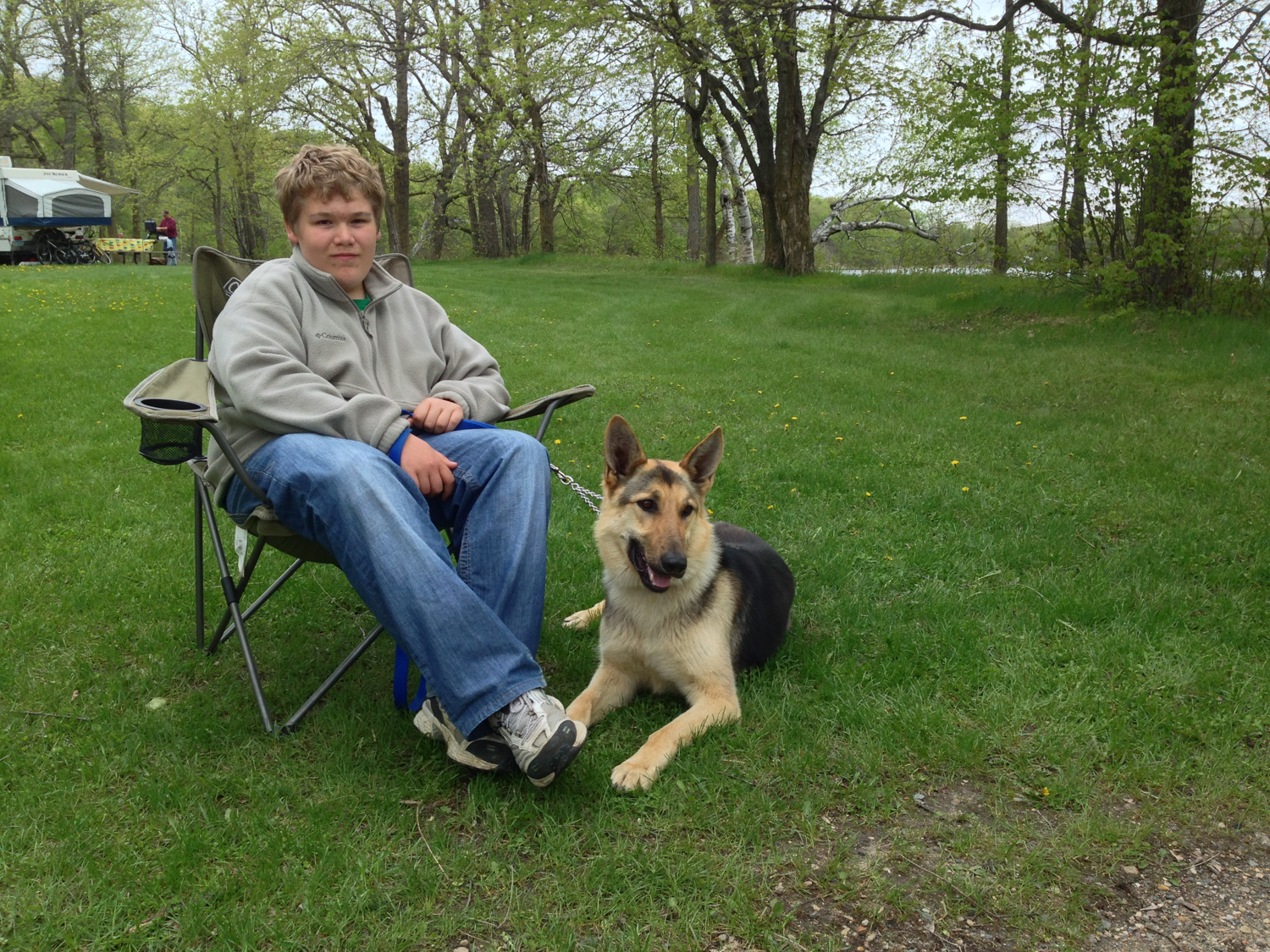 Jacob and Max (the wonder dog) hanging out near the campfire.