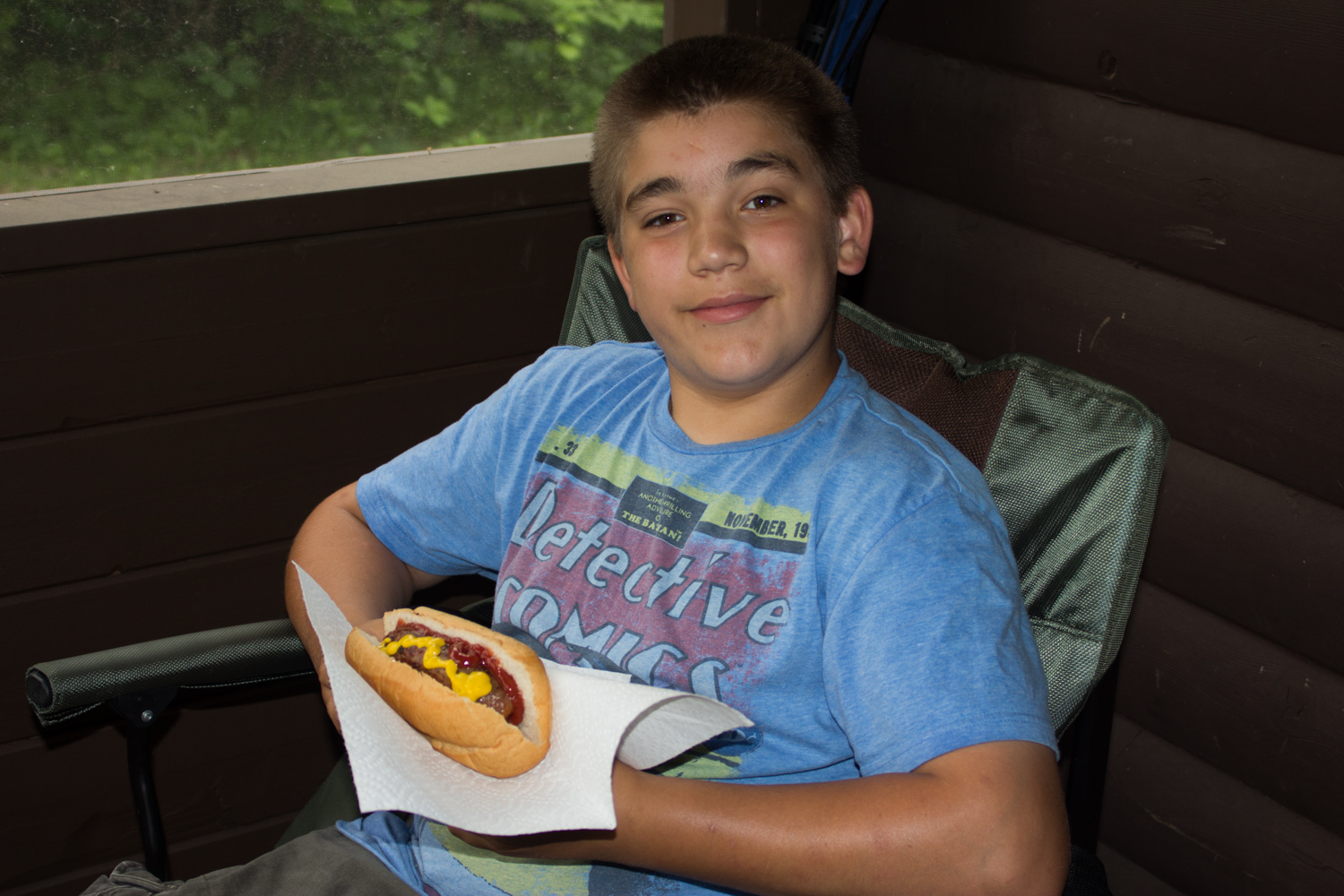 Ben eating lunch on Saturday inside the screen porch of the cabin.