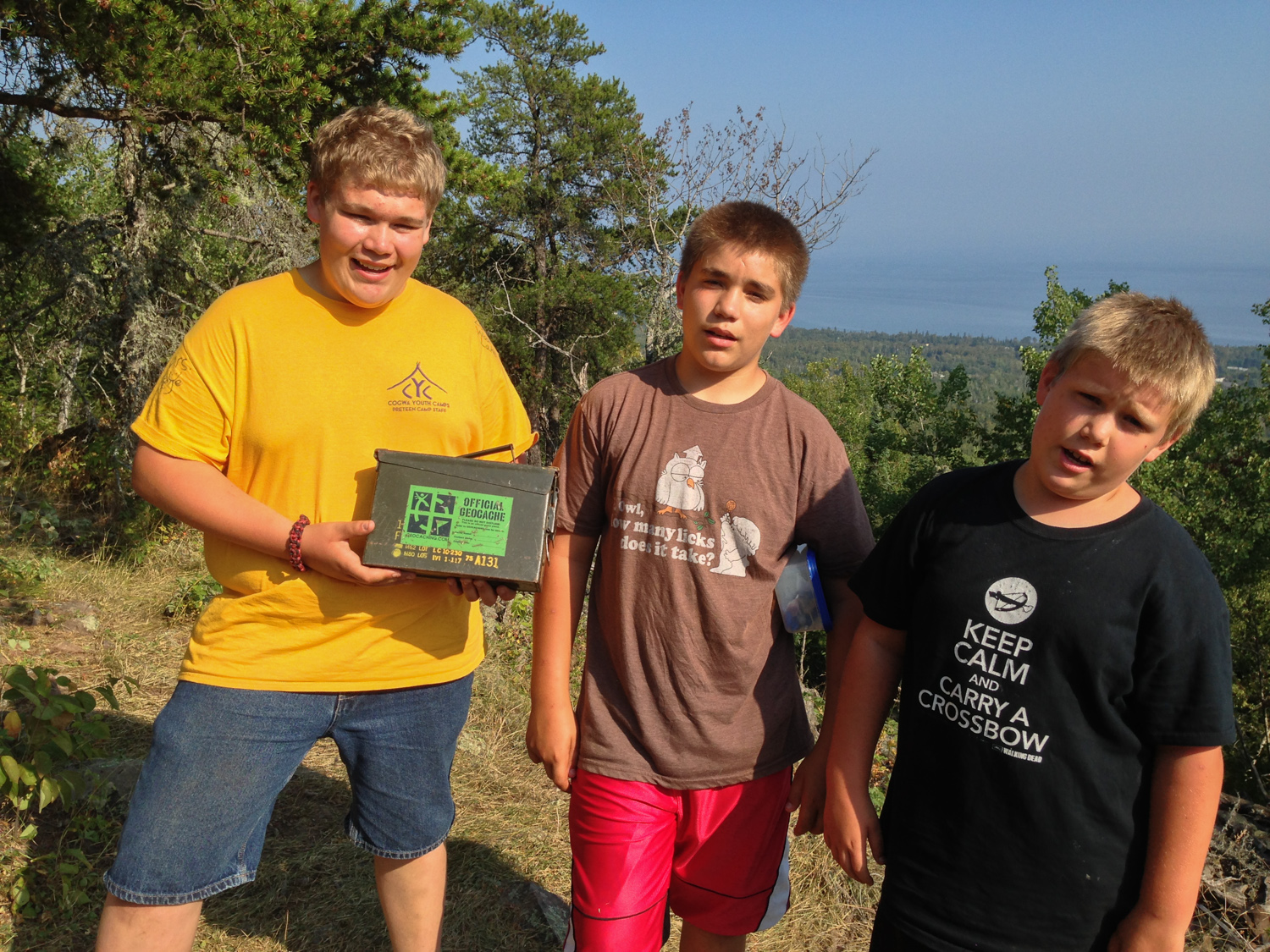 Jacob, Ben, and Joe with a geocache after a LONG hike in the woods