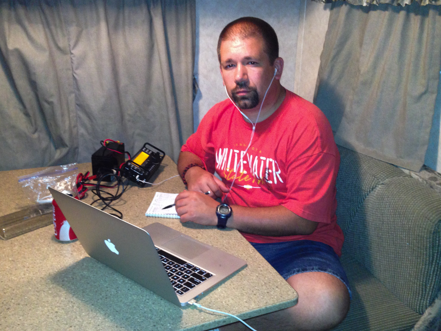 John (NG0R) operating the Elecraft KX3 from the inside of the camper on a buggy night.