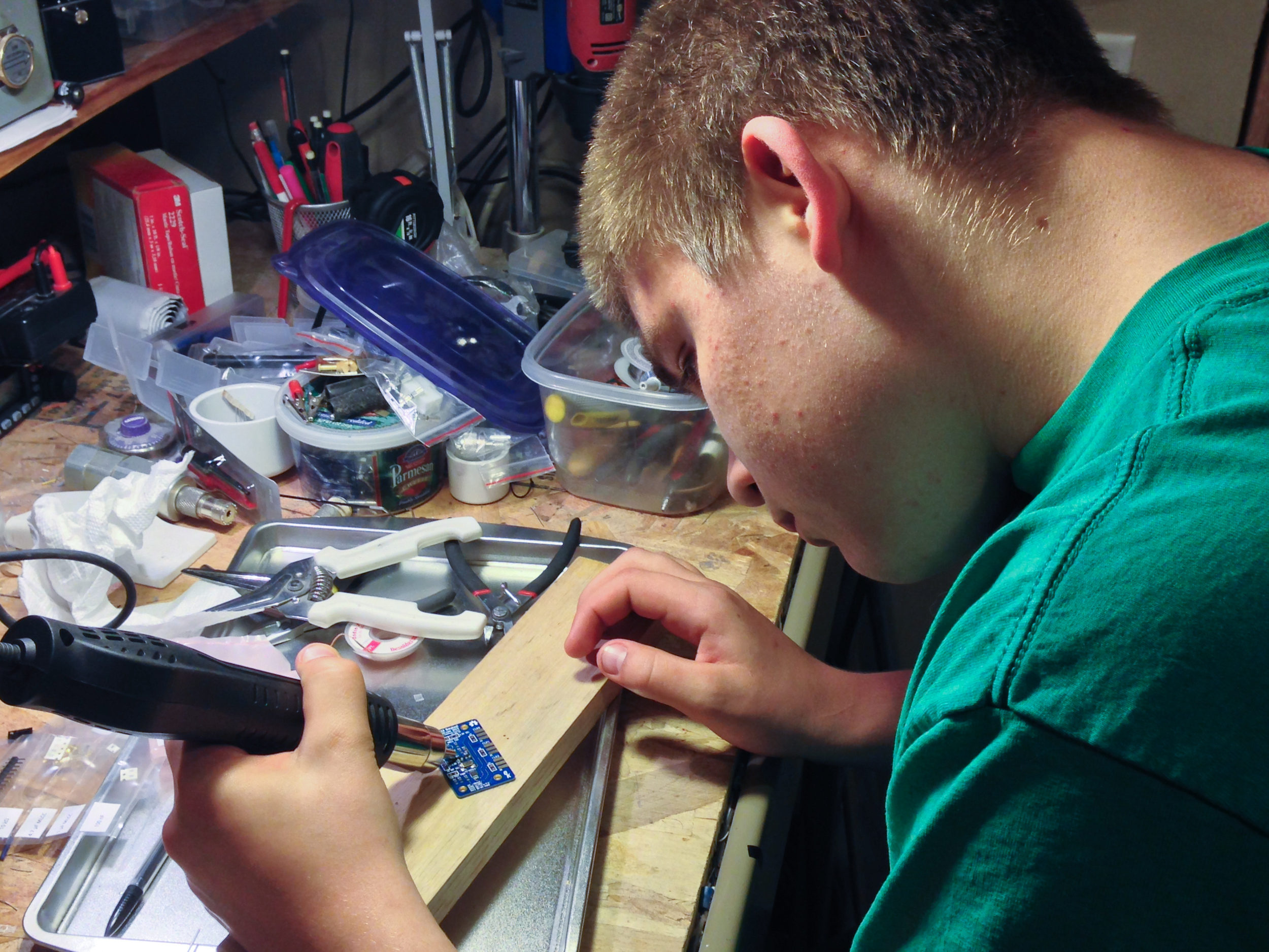 Ben (N2BEN 14) is using the reflow station for the first time after watching me
