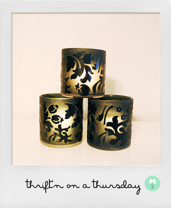 black_candleholders_flower_silhouette_black_vases_floral_design.jpg