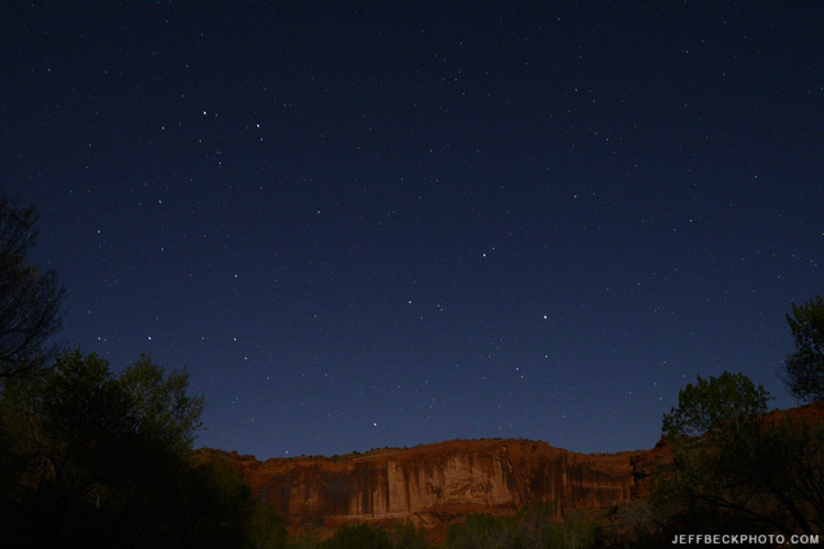 Moonlight illuminates the canyon wall from my camp beside the Escalante River.