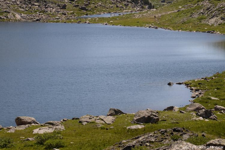 CDT thru-hiker cruises along Upper Jean Lake.