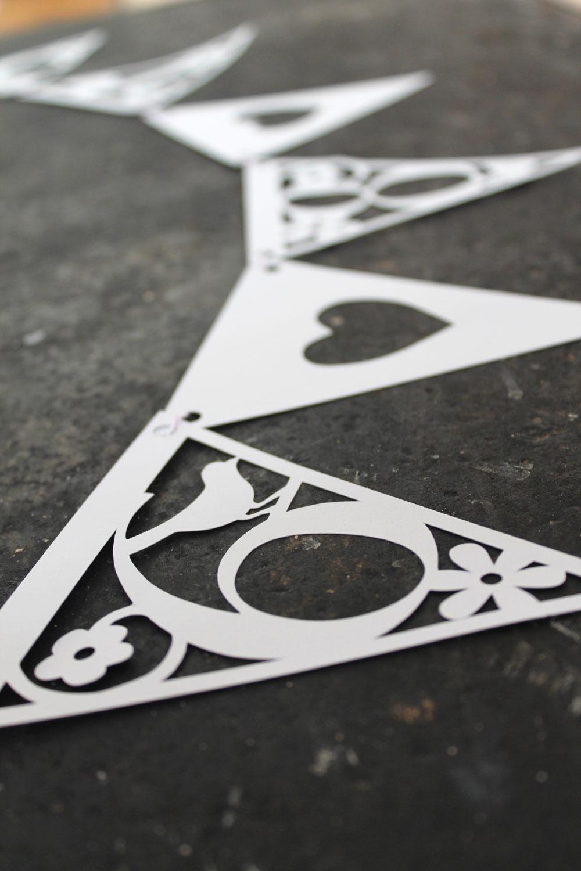 Memorable date papercut bunting from Studio Seed