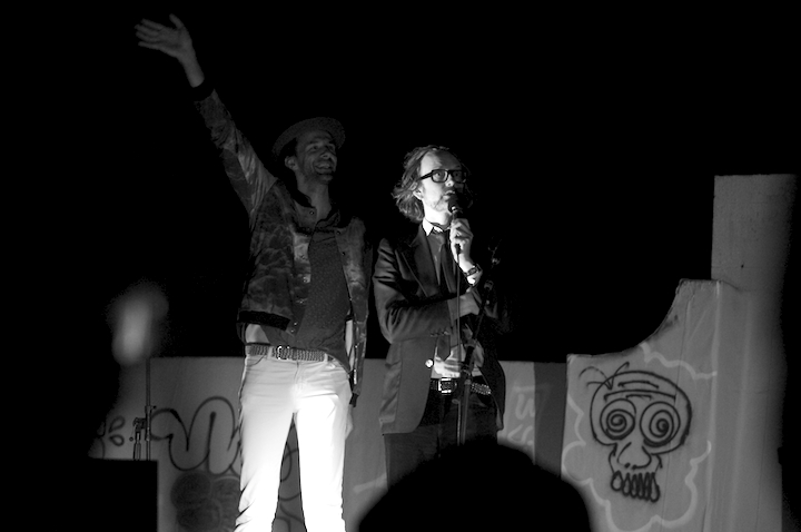 "Filmmaker Florian Habicht and Jarvis Cocker waving to the audience on the ""other"" roof."